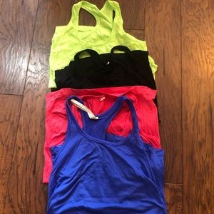 Woman's Fabletics workout tops in EUC size medium!